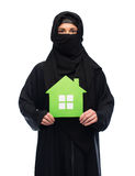Muslim woman in hijab with green house over white Royalty Free Stock Images