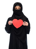 Muslim woman in hijab holding red heart Stock Images