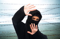 Muslim woman in hijab making protective gesture. Crime, imprisonment, violence, refugee and people concept - muslim woman in hijab making protective gesture over royalty free stock image