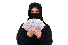 Muslim woman in hijab with money over white Stock Image