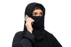 Muslim woman in hijab over white background Stock Image