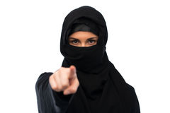 Muslim woman in hijab pointing finger to you. Religious and people concept - muslim woman in hijab pointing finger to you over white background Stock Photos