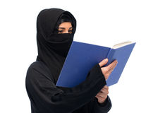 Muslim woman in hijab reading book over white Stock Photo