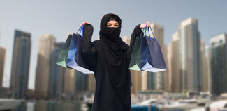 Muslim woman in hijab with shopping bags in dubai Royalty Free Stock Images