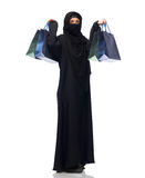 Muslim woman in hijab with shopping bags. Sale, consumerism and people concept - muslim woman in hijab with shopping bags over white background Stock Photos