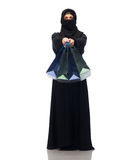 Muslim woman in hijab with shopping bags. Sale, consumerism and people concept - muslim woman in hijab with shopping bags over white background Royalty Free Stock Photos