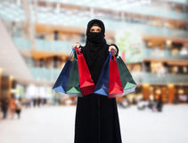 Muslim woman in hijab with shopping bags Royalty Free Stock Photography