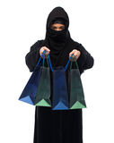Muslim woman in hijab with shopping bags Royalty Free Stock Photos