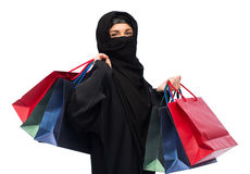 Muslim woman in hijab with shopping bags Royalty Free Stock Image