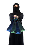Muslim woman in hijab with shopping bags Royalty Free Stock Images