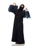 Muslim woman in hijab with shopping bags Stock Photography