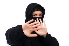 Muslim woman in hijab showing stop sign Stock Photography