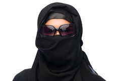 Muslim woman in hijab and sunglasses over white. Accessory, fashion and people concept - muslim woman in hijab and sunglasses over white background Stock Photos
