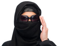 Muslim woman in hijab and sunglasses over white. Accessory, fashion and people concept - muslim woman in hijab and sunglasses over white background Royalty Free Stock Photography
