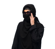 Muslim woman in hijab and sunglasses over white. Accessory, fashion and people concept - muslim woman in hijab and sunglasses over white background Royalty Free Stock Images