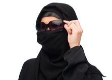 Muslim woman in hijab and sunglasses over white. Accessory, fashion and people concept - muslim woman in hijab and sunglasses over white background Stock Images