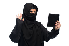Muslim woman in hijab with tablet pc computer Royalty Free Stock Photography
