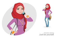 Muslim woman in hijab talking on the phone. Islamic culture in the modern world. Modest girl honors tradition Royalty Free Stock Images