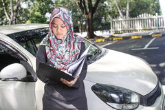 Muslim woman holding a file Royalty Free Stock Image