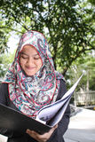 Muslim woman holding a file Royalty Free Stock Photo