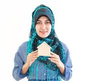 Muslim Woman holding a house model for housing concept royalty free stock images
