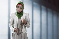 Muslim woman holding prayer beads Stock Image