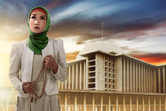 Muslim woman holding prayer beads Stock Photography