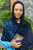Muslim Woman Holding Qur'an Stock Photography