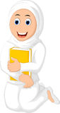 Muslim Woman with Hugging a Book Wearing white Veil Royalty Free Stock Photography