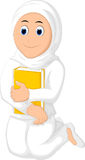 Muslim Woman with Hugging a Book Wearing white Veil Royalty Free Stock Image
