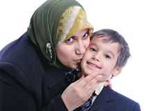 Muslim woman kissing son Stock Photo