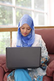 Muslim woman with laptop Stock Photos