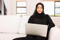 Muslim woman laptop home Stock Photos