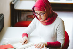 Muslim woman at the library. Muslim woman studying at the library Royalty Free Stock Image