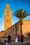 Muslim woman looking at Koutoubia Mosque,Morocco stock images