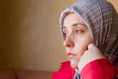 Muslim woman lost in thoughts Royalty Free Stock Photos