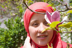 Muslim woman and magnolia flower royalty free stock images