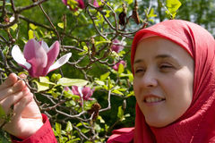 Muslim woman and magnolia flower Royalty Free Stock Photography