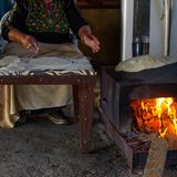 Muslim woman making food. royalty free stock images
