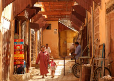 Muslim woman in the medina. Muslim woman walking with her daughter in the Meknes medina, Morocco Stock Photo