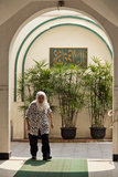 A muslim woman in a mosque. The picture was taken 20th, Sept 2012 at Xiaotaoyuan Mosque, shanghai, china. A muslim woman with a white scarf was walking through a Stock Photos