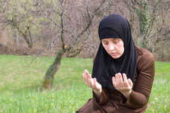 Muslim woman in nature Stock Photos