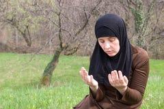 Muslim woman in nature Stock Photos