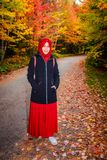 Muslim woman in North America. During autumn with colorful maple leaf as background stock photos