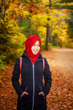 Muslim woman in North America. During autumn with colorful maple leaf as background royalty free stock photo