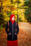 Muslim woman in North America. During autumn with colorful maple leaf as background stock photography