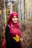 Muslim woman in North America during autumn Stock Images