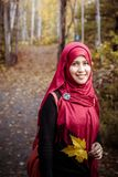 Muslim woman in North America during autumn Stock Photo