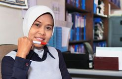 Muslim woman in office. Portrait of muslim woman in office Royalty Free Stock Photography