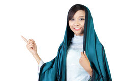 Muslim woman pointing at copyspace Stock Image